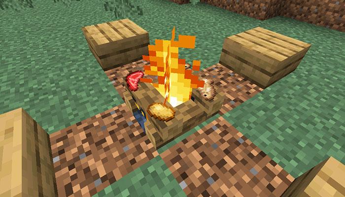 焚き火で食料を焼く